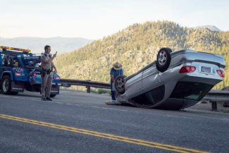 A one-car rollover backed up traffic on U.S. 50 near Echo Summit on Tuesday, June 24. Authorities are looking for a person who reportedly ran from the scene of the wreck and down a steep embankment on the side of the highway.