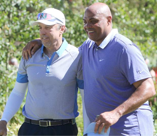 Comedian Kevin Nealon (left) and NBA Hall of Famer Charles Barkley (right) formed the last group of the day Friday. Barkley needed two tee shots on the first hole, but made initial contact both times.