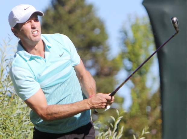 NHL Hall of Famer Mike Modano leans into his tee shot Friday morning.