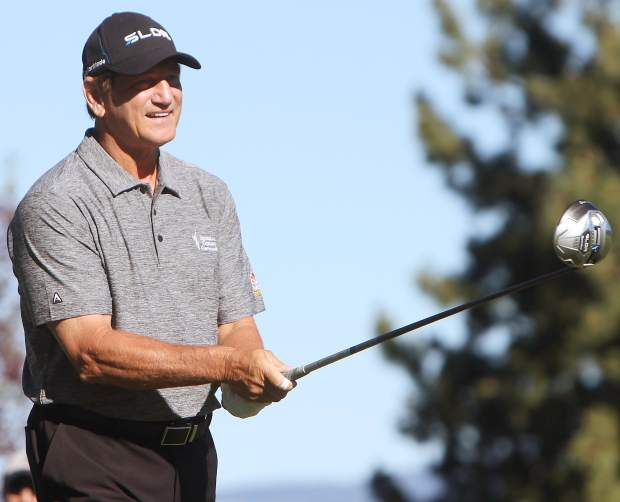 Former NFL Pro Bowl quarterback Joe Theismann sizes up his tee shot on the first hole Friday.