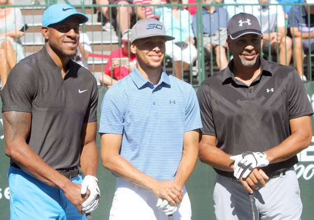 The marquee group of the American Century Championship first round Friday, July 22, at Edgewood Tahoe featured two-time NBA MVP Stephen Curry (middle) along with his father Dell Curry (right) and Warriors teammate Andre Iguodala.