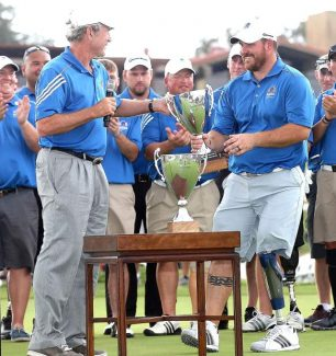 Former President George W. Bush, left, presents Cpl. Chad Pfeifer the Warrior Open trophy in 2013. Pfeifer will compete at this week's American Century Championship at Edgewood Tahoe Golf Course.