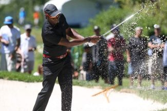 Jerry Rice hits a practice shot from the bunker at Edgewood on Tuesday.