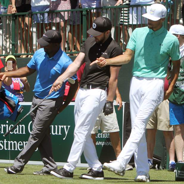 Alfonso Ribeiro, Justin Timberlake and Stephen Curry get in sync while performing the Jones BBQ and Foot Massage dance in the 17th tee box Sunday.