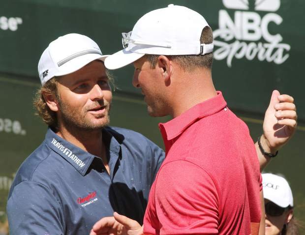 Mulder (right) congratulated by runner-up Mardy Fish as the former tennis pro walked off the 18th hole Sunday.