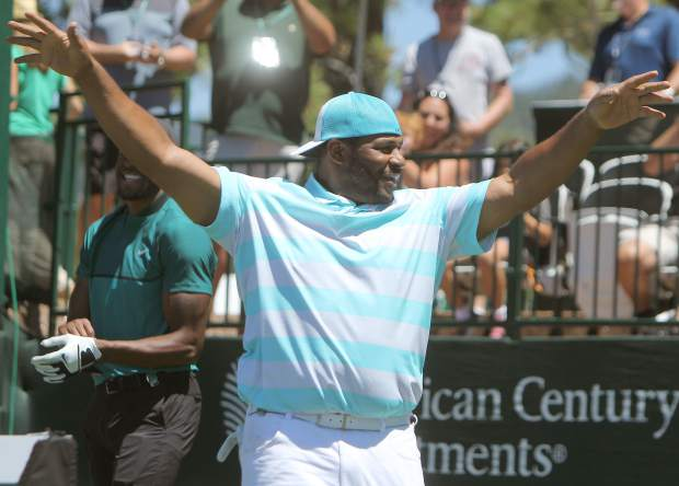 NFL Hall of Famer Jerome Bettis celebrates after knocking down a jump shot on the 17th hole Sunday.