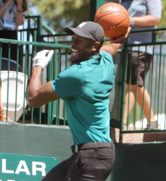 Golden State Warriors swingman Andre Iguodala tries a sky hook from the 17th tee box Sunday.