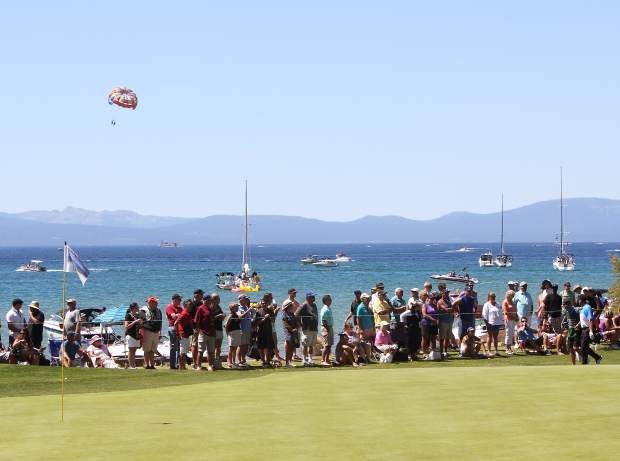 Former NHL All-Star Jeremy Roenick walks onto the 18th green in front of Lake Tahoe on Sunday.