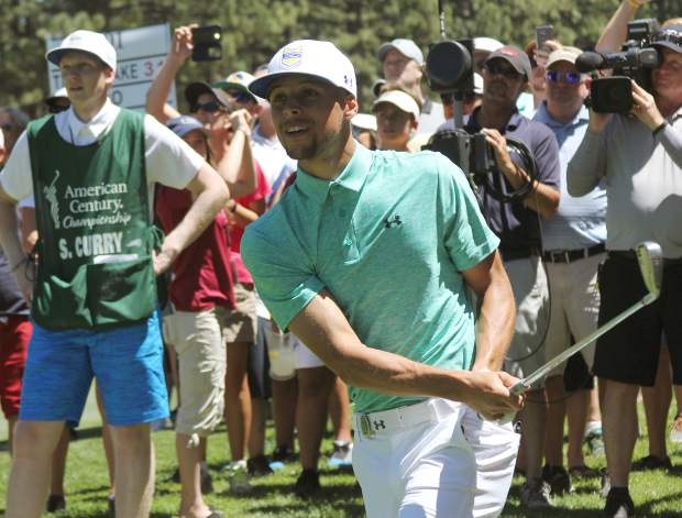 Two-time reigning NBA Most Valuable Player Stephen Curry eyes his approach shot from the 16th rough Sunday.