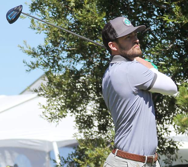 Justin Timberlake watches his tee shot from the first hole during the Lake Tahoe Celebrity-Am on Tuesday, July 19, at Edgewood Tahoe Golf Course.