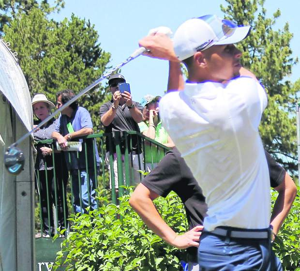Two-time reigning NBA MVP Stephen Curry holds his follow-through after teeing off his round Wednesday. The Golden State Warriors guard made his 2016 debut in a group that included his father Dell.