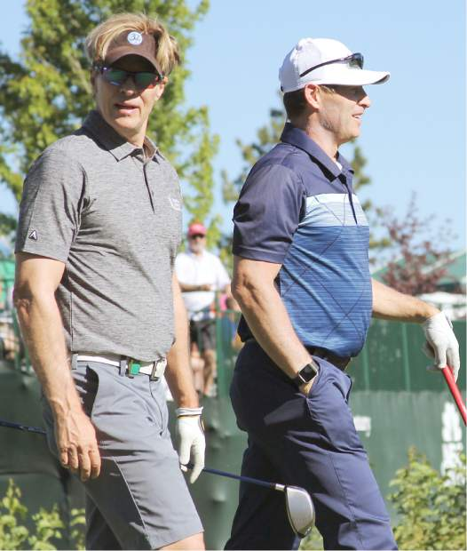 Actor Jack Wagner (left) and Hall of Fame quarterback Steve Young take off from the 10th tee at Edgewood Tahoe during a practice round.
