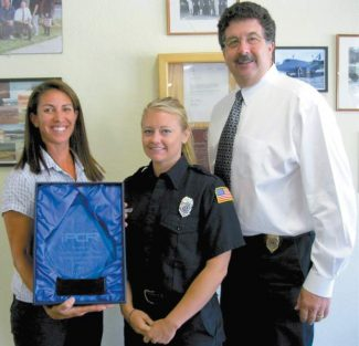 South Lake Tahoe Fire Department engineer/paramedic Kim George, firefighter/paramedic Sophie Tetlow and Chief Bruce Martin show off the award they received for technology innovation Tuesday.