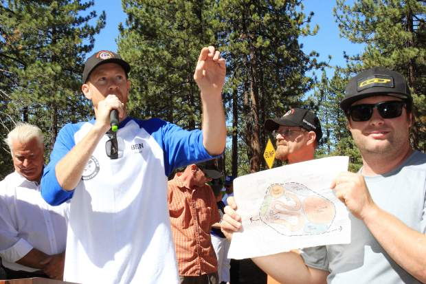 TAMBA president Ben Fish (left) gives a speech during the opening of the Bijou Bike Park in South Lake Tahoe.