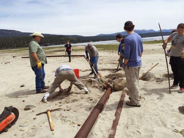 Volunteers from Cyrus Miller's Boy Scout Troop 228 work on a North Shore Eagle Scout project. Miller directed efforts to remove a large, old pipe obstructing the shoreline near Tahoe City.