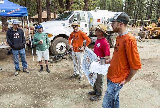 Ben Fish (right) and other TAMBA officials direct volunteer efforts at the Bijou Bike Park.