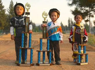 Friday night was the Bob Warnicke Memorial Scholarship fundraiser race and also the final race in the Strider Series at the South Lake Tahoe BMX track. It was not the last race of the season for bikes, but the Striders were awarded trophies based on their 10 best results from the season. Left to right: Greyson Kane in first place, Carter Moynihan in second and Matteo DeLeon in third. For full BMX results see page 16.