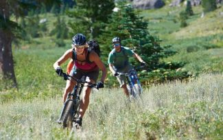 Mountain bikers make some turns at Kirkwood Mountain Resort's bike park. The park will be included with four other mountain bike parks, including Northstar California, on a single pass this summer.