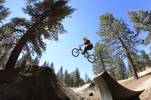 A bike rider airs off a jump feature at Bijou Bike Park last year.