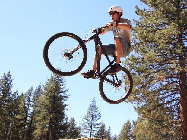 A bike rider airs off a jump feature at the Bijou Bike Park, during opening day celebrations, Saturday, Sept. 19.