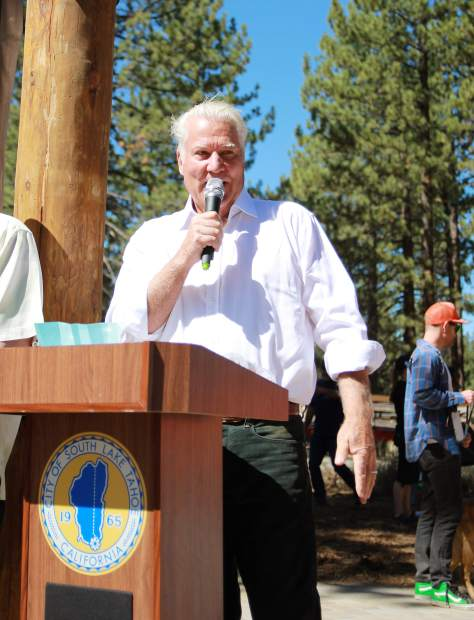 South Lake Tahoe Mayor Hal Cole speaks in front of a large crowd at the Bijou Bike Park opening. Cole credited the park as a shinning example of what community-led initiatives can accomplish.