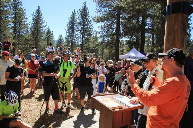 Pete Fink, city parks and recreation commission vice chair, speaks in front of a large crowd during the opening of the Bijou Bike Park, Saturday, Sept. 19. Fink credited the park as a joint effort between the city and the community.