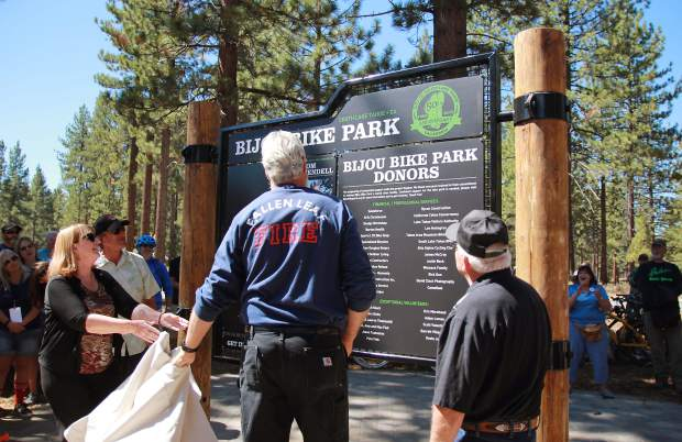 Ted Wendell unveils the new Bijou Bike Park sign at the park's grand opening. The park was dedicated to Wendell's brother, Tom, who passed away in 2013.
