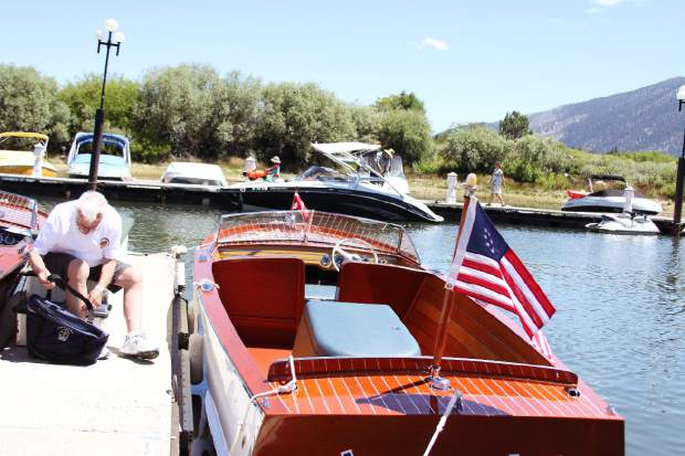 John Wendt watches over the Joltin' Joe during the South Tahoe Wooden Boat Classic on Saturday at Tahoe Keys Marina. The boat, once owned by baseball legend Joe DiMaggio, was restored over a period of more than five years after decades of neglect. It one first place in the most improved boat category.
