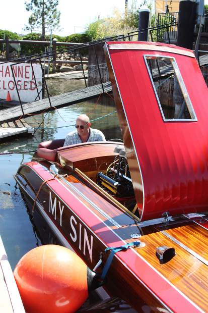 Scott Courts checks the engine of My Sin during the South Tahoe Wooden Boat Classic at the Tahoe Keys Marina July 25. For more photos from the event, turn to page 19.