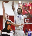 Whittell senior Quinn Kixmiller sneaks a transition layup under McQueen's Octavian Corley during the Local Sports Program Senior All-Star boys basketball game last Thursday, May 26, at Wooster High.