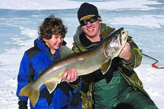 Slade Conboy and his dad, Doug, caught this 10-pound mackinaw last week at Caples Lake.