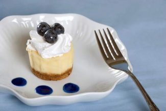 Cheesecake with fresh blueberries and a fork