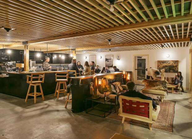 The Coachman Hotel's communal space (pictured) and coffee bar will also be open to the public and is designed as a community gathering spot.