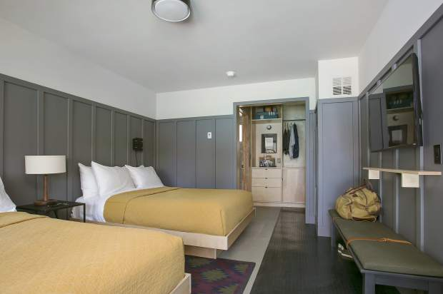 The complex's old 1960s-area motel rooms were gutted and modernized, complete with Apple TV and gear drying areas.