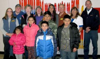 Bijou School Principal Cindy Martinez (center, back row) and members of the Kiwanis Club of Lake Tahoe and Kiwanis Club of Tahoe Sierra are shown with students showing off their new jackets.