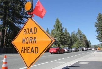 Motorists lineup behind road work on U.S. Highway 50 through South Lake Tahoe Thursday afternoon. Adam Jensen / Tahoe Daily Tribune