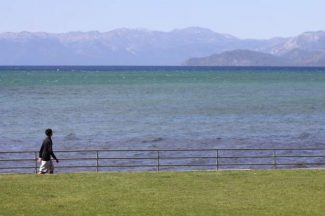 South Lake Tahoe resident Jordan Deas, 13, walks along Regan Beach Tuesday afternoon. Parking at the area will remain free following a Tuesday decision by the South Lake Tahoe City Council. Adam Jensen / Tahoe Daily Tribune
