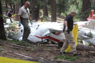 Investigators examine the wreckage of a small plane that crashed in South Lake Tahoe Monday morning.