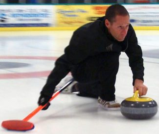 A member of Lake Tahoe Epic Curling makes a play.