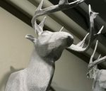 The staff at Slifer Designs loves these papier-mâché stag heads crafted in Haiti, made from recycled materials.