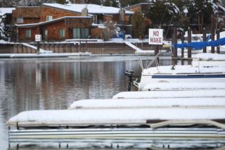 Snow-covered docks in the east Tahoe Keys channel are shown Tuesday.
