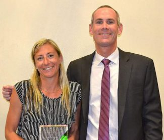 EDCOE Superintendent of Schools Jeremy M. Meyers with Excellence in Education award winner, Jamie Frink.