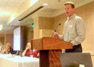 Mike Cook of Caltrans speaks about recent projects during an economic forum Tuesday.
