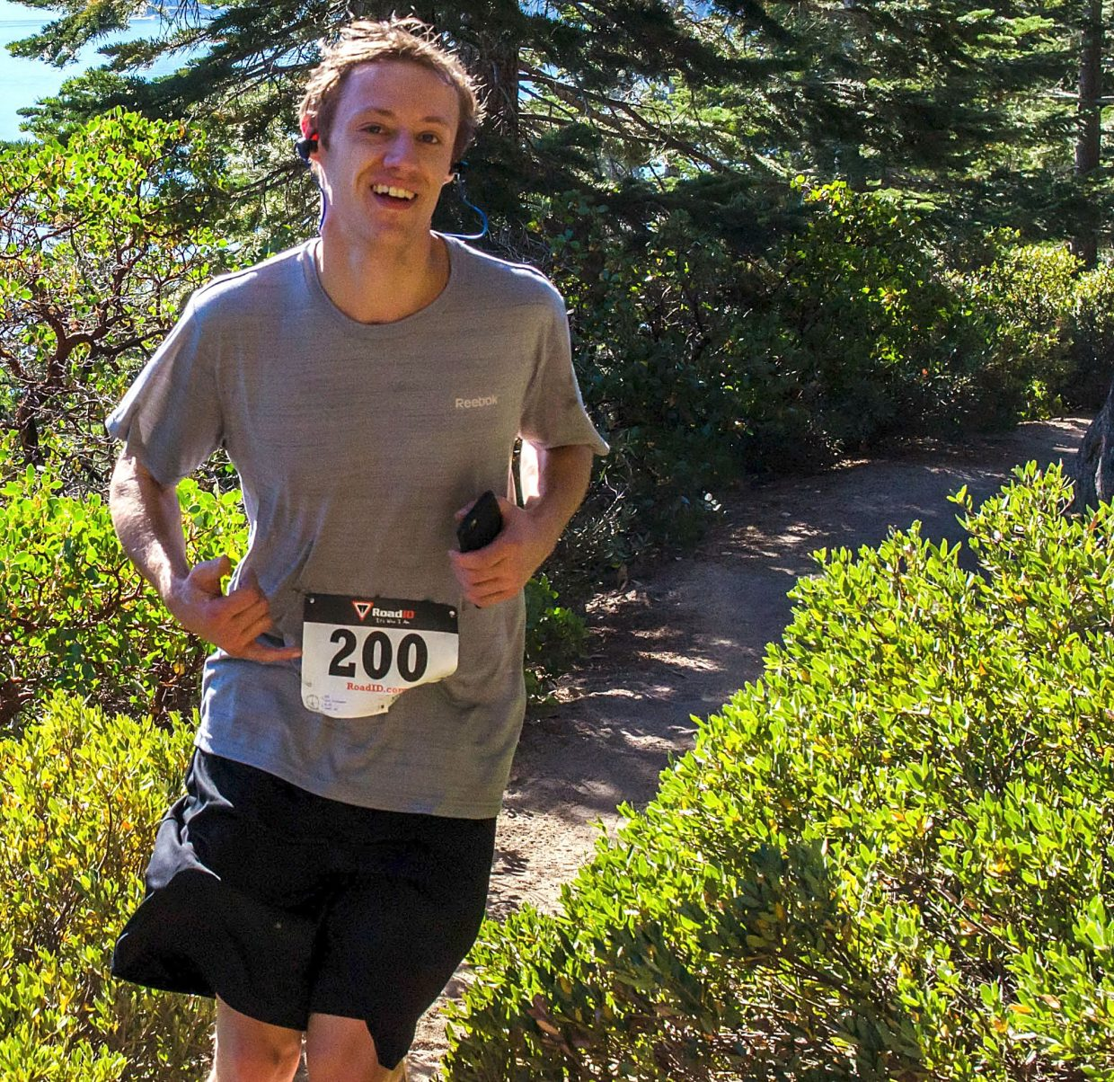 South Shore runner Christopher Lyon hangs loose during the Emerald Bay Trail Run on Sunday.