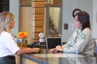 Lake Tahoe Basin Management Unit employees Gina Thompson, left, a recreation staff officer, and information assistant Jean Norman discuss business Thursday at the Supervisor's Office in South Lake Tahoe.