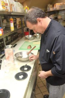 Peter Brinckerhoff prepares a beef tenderloin salad wrap for a previous Fall Food Fest.