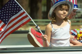 A young girl waves an American flag during South Lake Tahoe's Fourth of July parade last year.