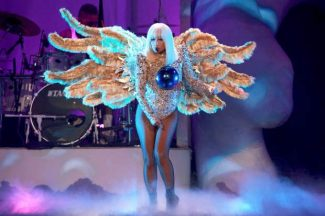 "Lady Gaga performs onstage during the ""artRave: The Artpop Ball"" tour July 11 at the United Center  in Chicago, Ill."