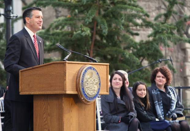 As his family looks on, Gov. Brian Sandoval speaks to a large crowd at his inaugural ceremony on Jan. 5.