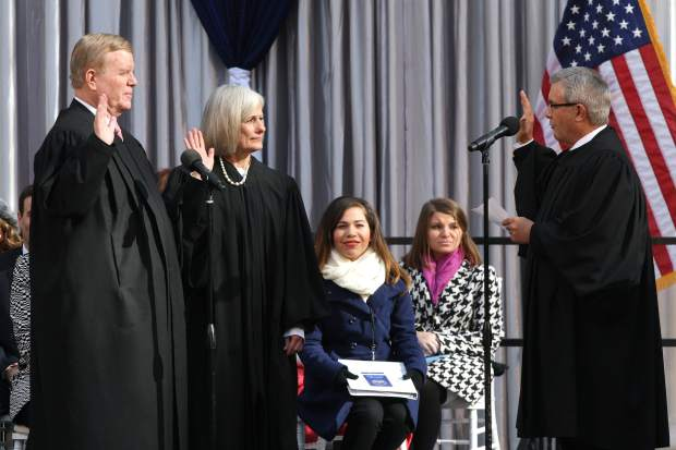 Supreme Court Justices Mark Gibbons and Kris Pickering take the oath of office on Monday.